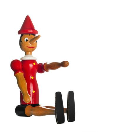 collodi: Pinocchio Toy Statue isolated on white Background Stock Photo