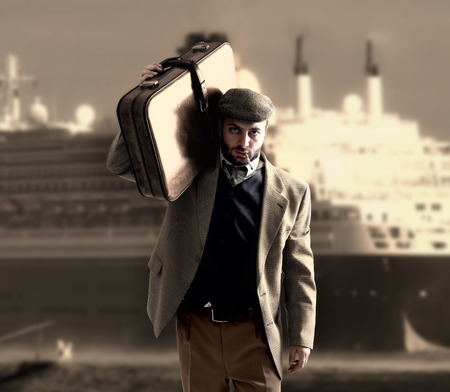 illegal immigrant: Emigrant man with the suitcases with a transatlantic ship behind