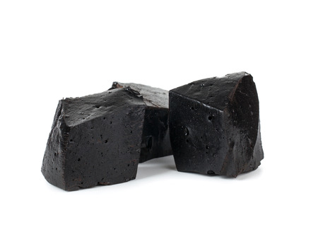 out of production: Pure blocks of black licorice on white background.