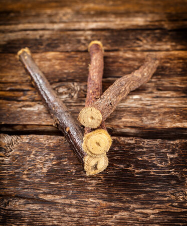 Close up of Licorice roots on wooden table. photo