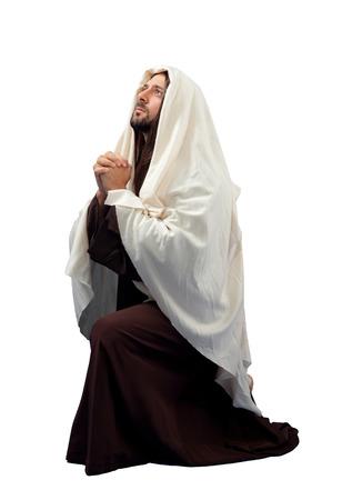 Jesus Christ full lengthin knee  on white background. Stock Photo