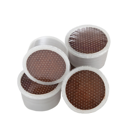 Coffee pods for espresso on white background. photo