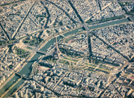 arial views: Aerial view from airplane of Paris with Eiffel Tower .