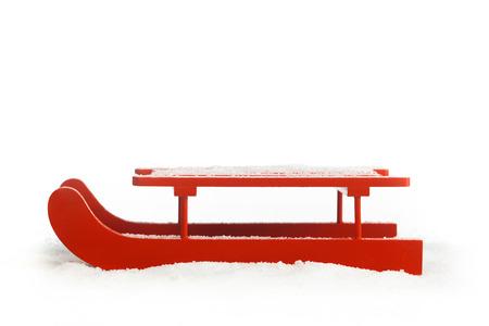Fából készült piros szán elszigetelt fehér háttér Stock fotó