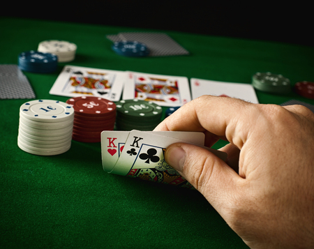 Poker concept with cards on green table photo