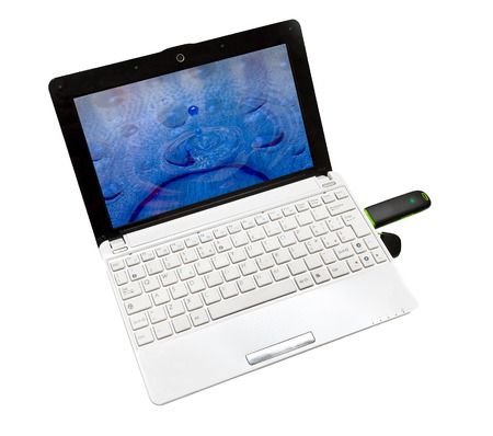 netbook: White small netbook with internet key on white background