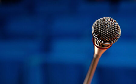 communication concept: Close up of a microphone in conference hall. Stock Photo
