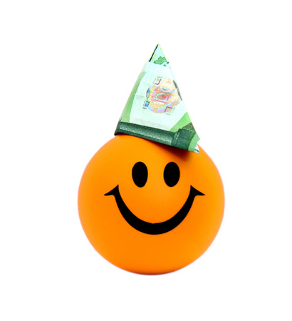 one hundred euro banknote: Smiling ball with a hat made of one hundred euro banknote on white.
