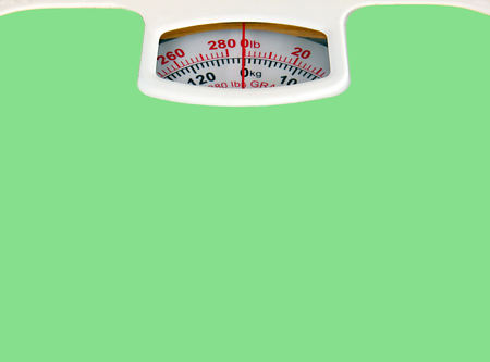 bathroom scale: Green bathroom scale isolated on white background