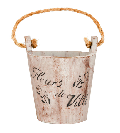 Empty wooden bucket or wooden flowerpot on white. photo