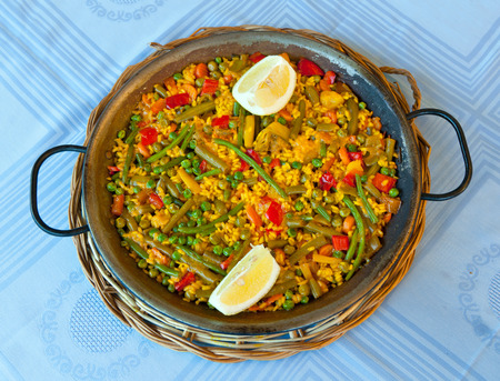 Traditional Spanish rice: Paella and vegetables - Vegetarian recipe Stock Photo