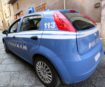 arrests: MONDRAGONE, ITALY – OCTOBER 10 2013:  Wide angle photograph of a car of the Italian police during the demonstration against the Mafia The March For Life.