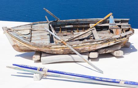 firostefani: View of old boat on the roof Santorini village Firostefani. Stock Photo