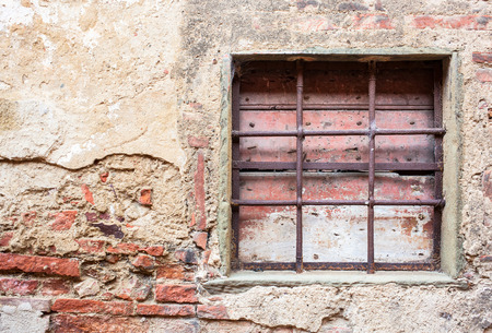 gratings: Old window with iron gratings of a house in Tuscany. Stock Photo