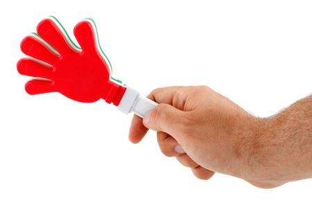 part frog: Toy in the shape of hand to make noise. Made of plastic and colors of the Italian flag.