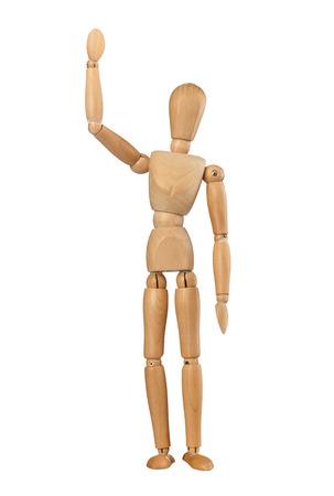 Wooden dummy man waving hello on white background photo