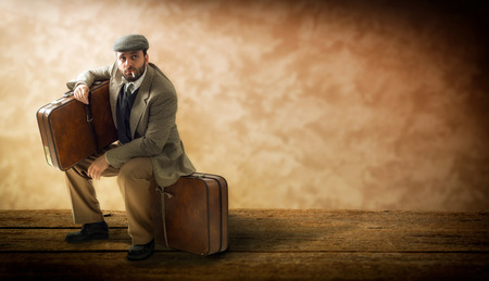 emigrant: Emigrant with cardboard suitcases on a wooden floor. Stock Photo