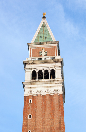 saint marks square: Bell tower in Saint Marks square on blue sky, Venice, Italy.