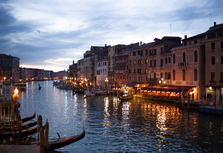 rialto: Night view of Grand Canal from Rialto bridge with gondolas in Venice. Italy