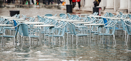 saint mark's square: Tables and chairs with high water in Saint Marks square, Venice, Italy.