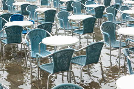 saint marks square: Tables and chairs with high water in Saint Marks square, Venice, Italy.
