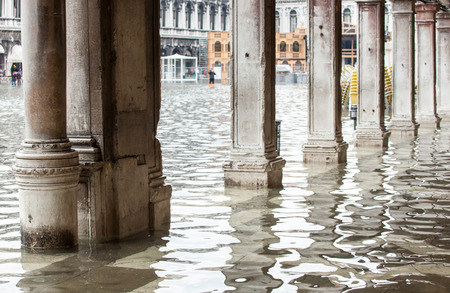procuratie: View of the arcades of the Piazza San Marco with high water in Venice, Italy.