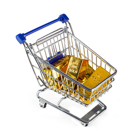 shopping cart isolated: Five gold bars in shopping cart isolated on white background.