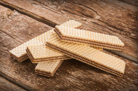 wafers: Wafers with chocolate on rustic wooden table.