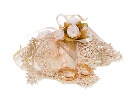 favor: Favor with tulle and wedding rings on white background.