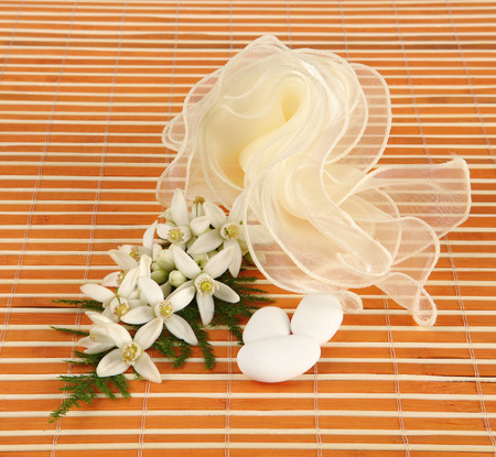 favor: Favor with tulle and jasmine on white background. Stock Photo