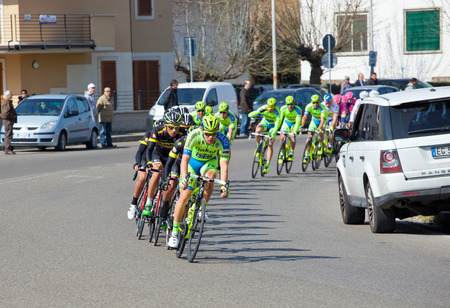 "internationally: EMPOLI, ITALY - MARCH 13, 2015: The Tirreno-€""Adriatico cycling race. The race is an elite internationally recognized cycle following a route between two coasts on March 13,2015 in Empoli. Editorial"