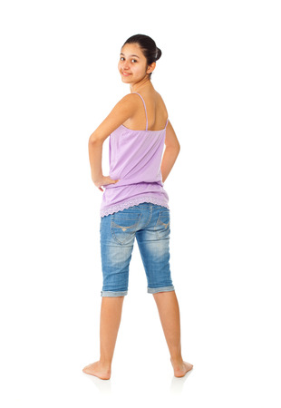 full figure: Teen girl with blue jeans and tank top on white background