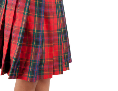 anglo saxon: Close up of a red skirt Scottish on white background. Stock Photo