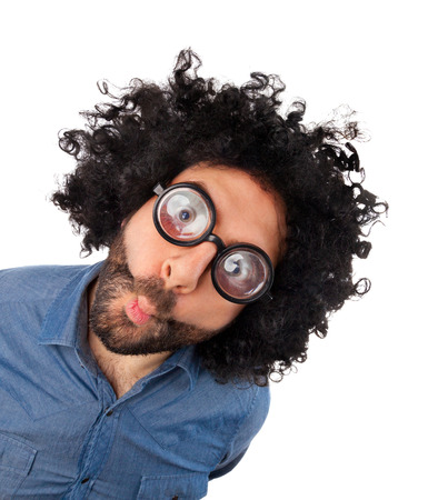 WOW, funny young man with unkempt hair and thick glasses on white background.