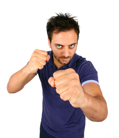 youth crime: Young Aggressive Man Show His Fists on white background.