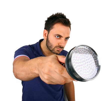 man searching: Man searching with flashlight on white background. Stock Photo
