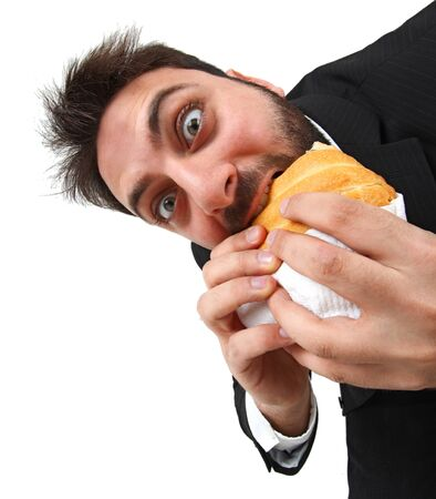 quickly: Young man while eating quickly a sandwich on white background.
