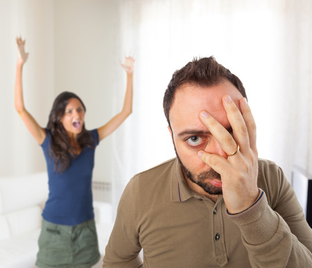 unbearable: Relationship problems between husband and wife in the home. Stock Photo