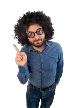 uncombed: Funny man with the wig while pointing with the finger an empty space Stock Photo