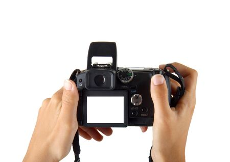 grabbing at the back: female hands taking picture with a compact digital camera Stock Photo