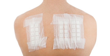 Skin Allergy Patch Test on Back of Male Patient On White Background Archivio Fotografico