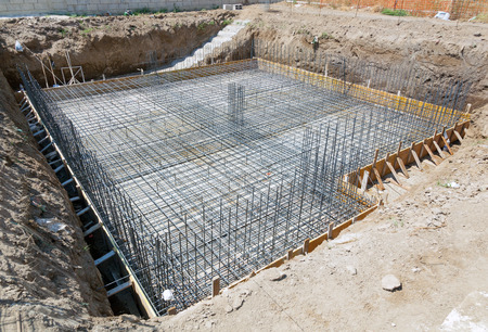 Foundation of a new house with reinforced concrete. Archivio Fotografico
