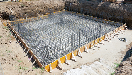concrete structure: Foundation of a new house with reinforced concrete. Stock Photo