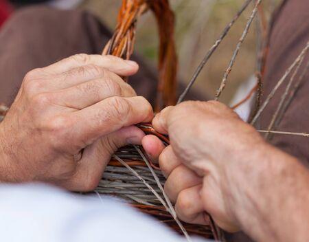 costruction: Close up og hands working in a basket costruction