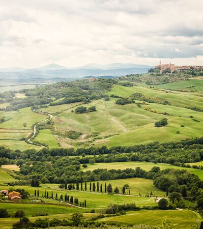 View of the town of Pienza with the typical Tuscan hills from locality of Monticchiello. Stock Photo