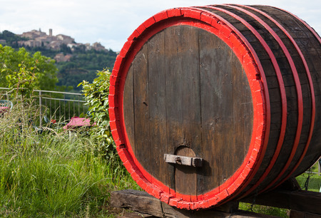 montepulciano: Wine barrels and the hilltop town of Montepulciano, Tuscany, Italy.