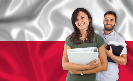 parlance: Couple of young students with books over polish flag