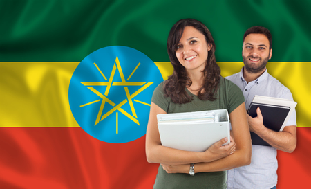 parlance: Couple of young students with books over Ethiopian flag Stock Photo