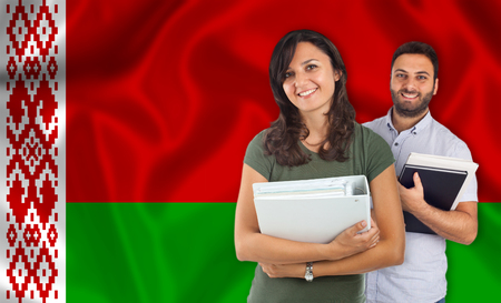 internships: Couple of young students with books over Belarusian flag Stock Photo