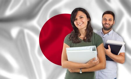 internships: Couple of young students with books overjapanese flag